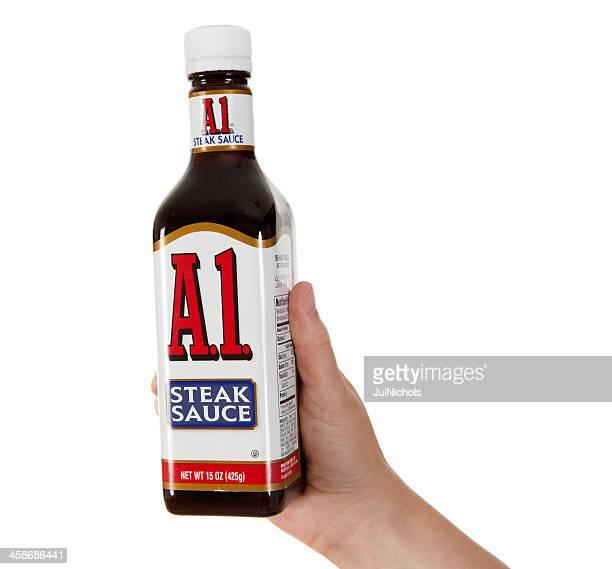 Hand Holding A1 Steak Sauce