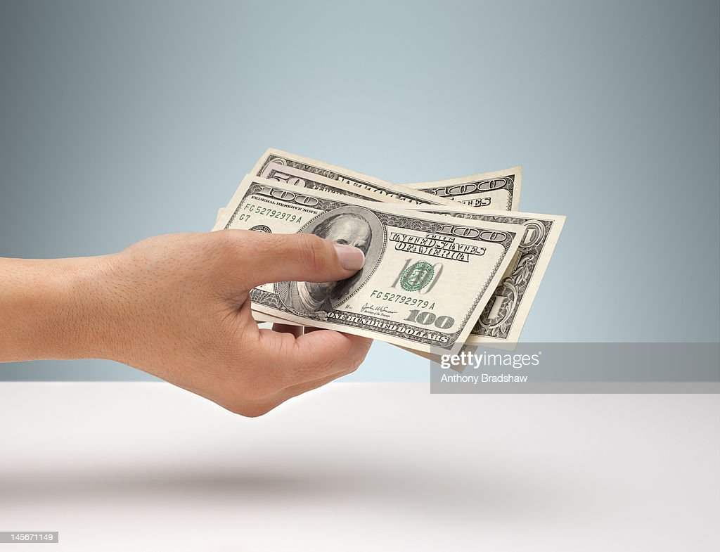 Hand holding American currency : Stock Photo