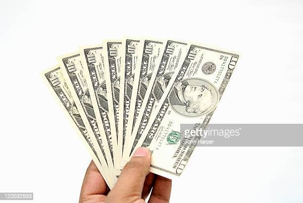 Hand holding American dollars