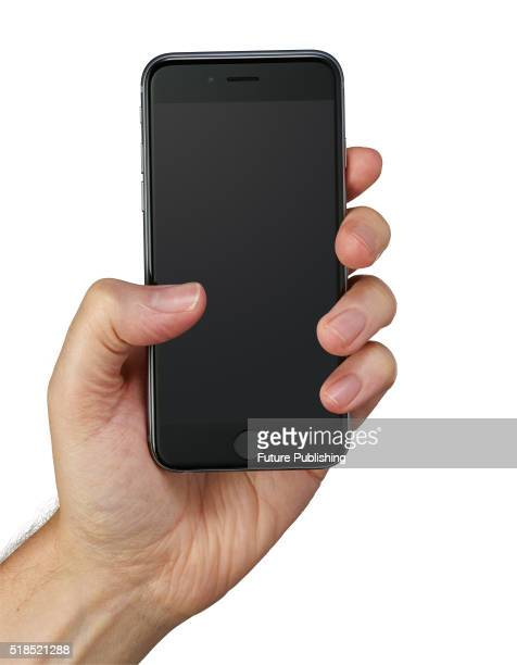 Hand holding an Apple iPhone 6S smartphone taken on September 14 2015