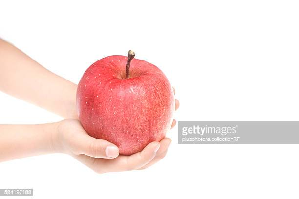 hand holding an apple - plusphoto stock pictures, royalty-free photos & images