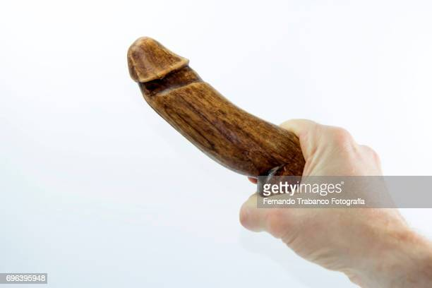 Hand holding an erect penis