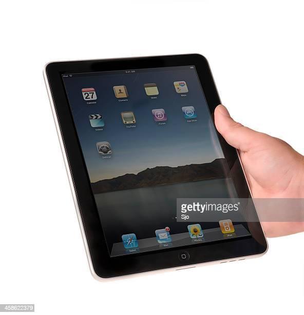 Hand holding an iPad