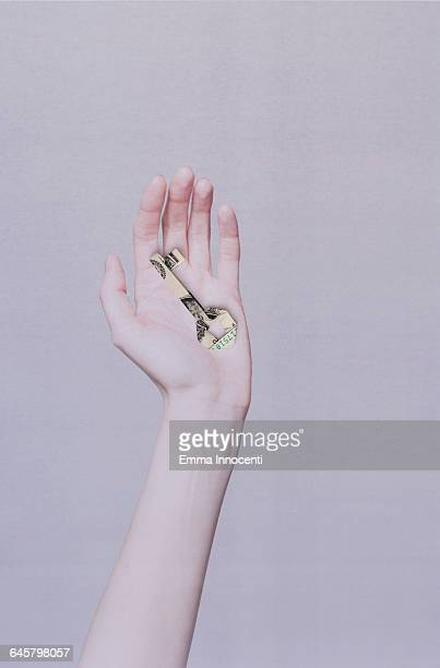 Hand holding an origami key