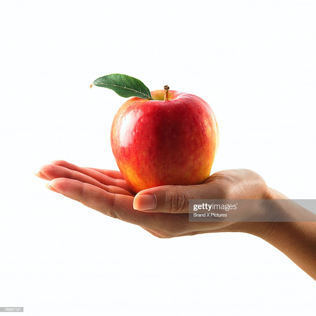 hand holding apple stock photo getty images
