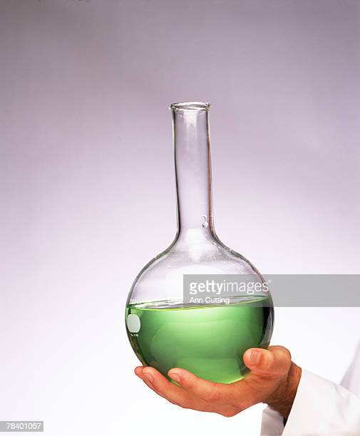 hand holding beaker - volume fluid capacity stock pictures, royalty-free photos & images