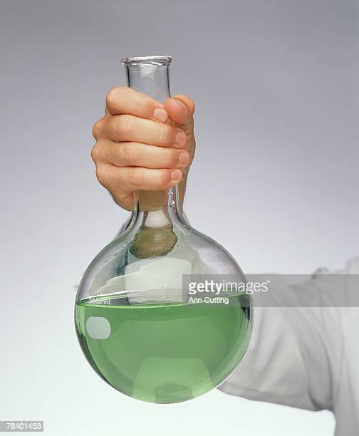 hand holding beaker with liquid - volume fluid capacity stock pictures, royalty-free photos & images