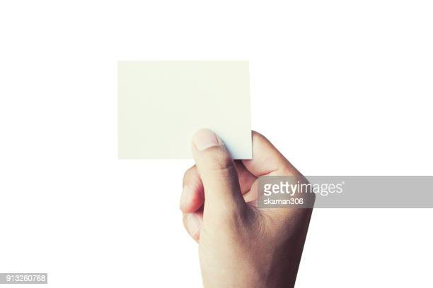 hand holding blank card with white background