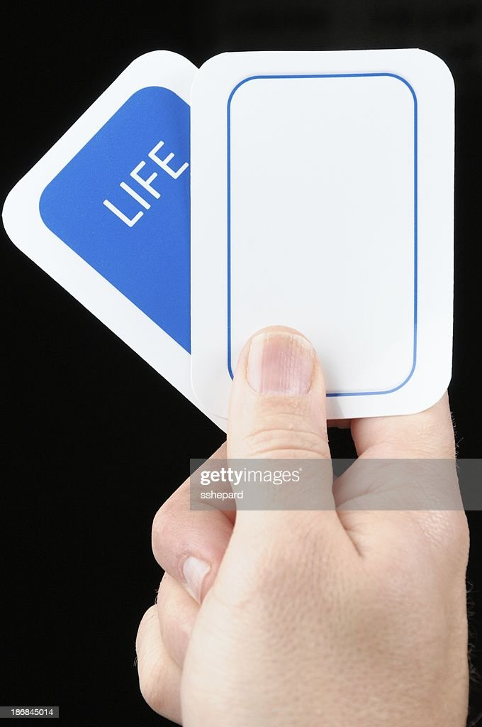 Hand holding blank life card : Stock Photo