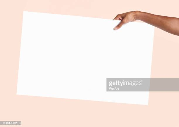hand holding blank sign - person holding blank sign stock pictures, royalty-free photos & images