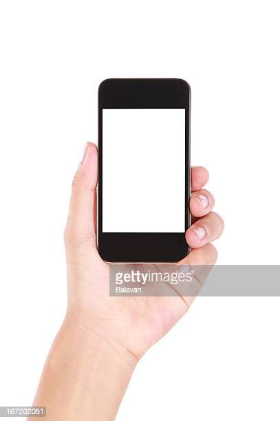 Mano sosteniendo teléfono inteligente en blanco sobre fondo blanco