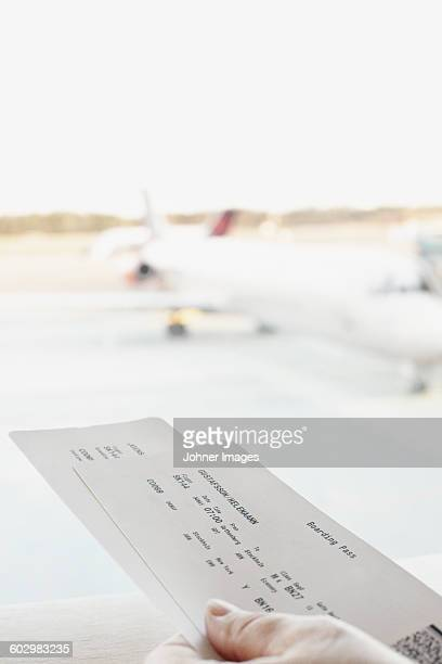 Hand holding boarding pass