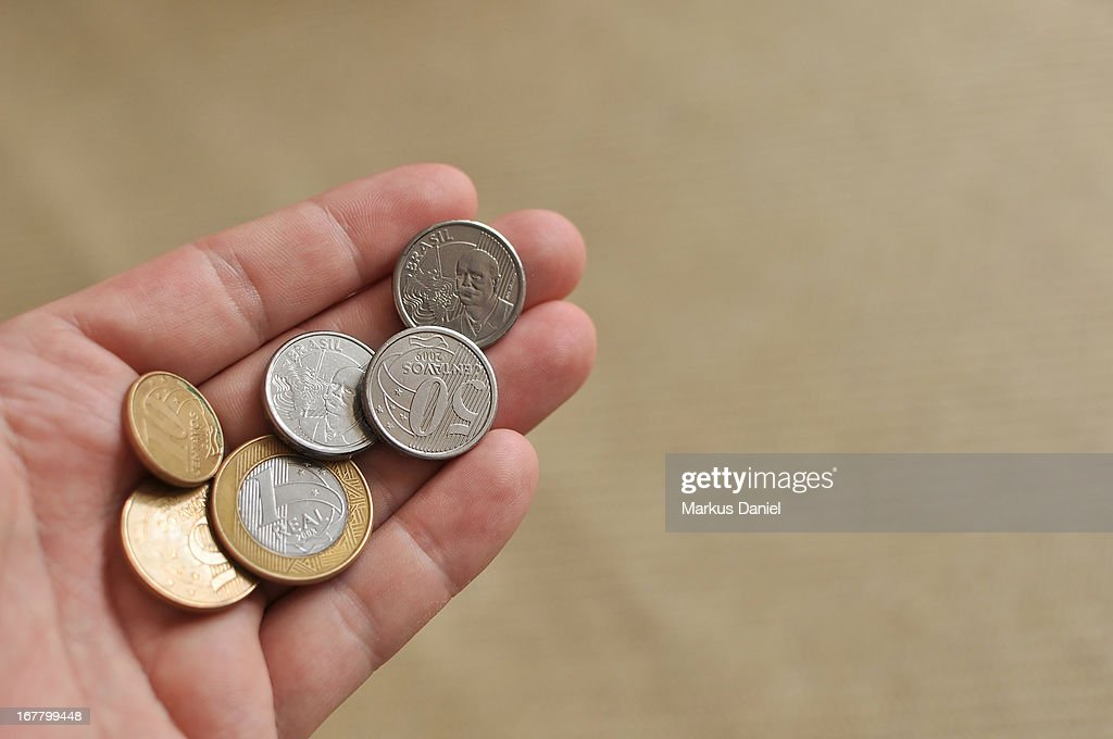 Hand Holding Brazil Coins Currency : Stock Photo