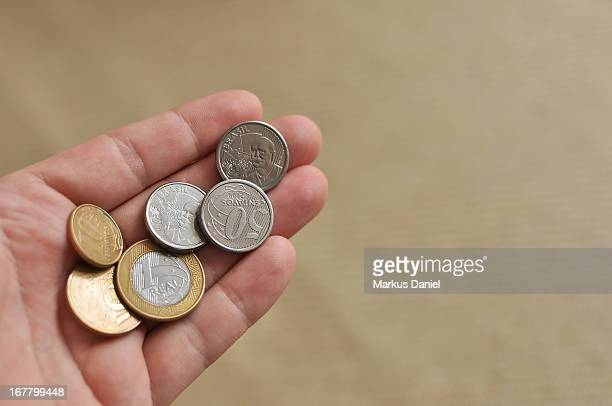 Hand Holding Brazil Coins Currency