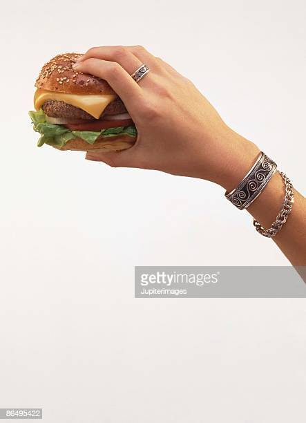 Hand holding burger