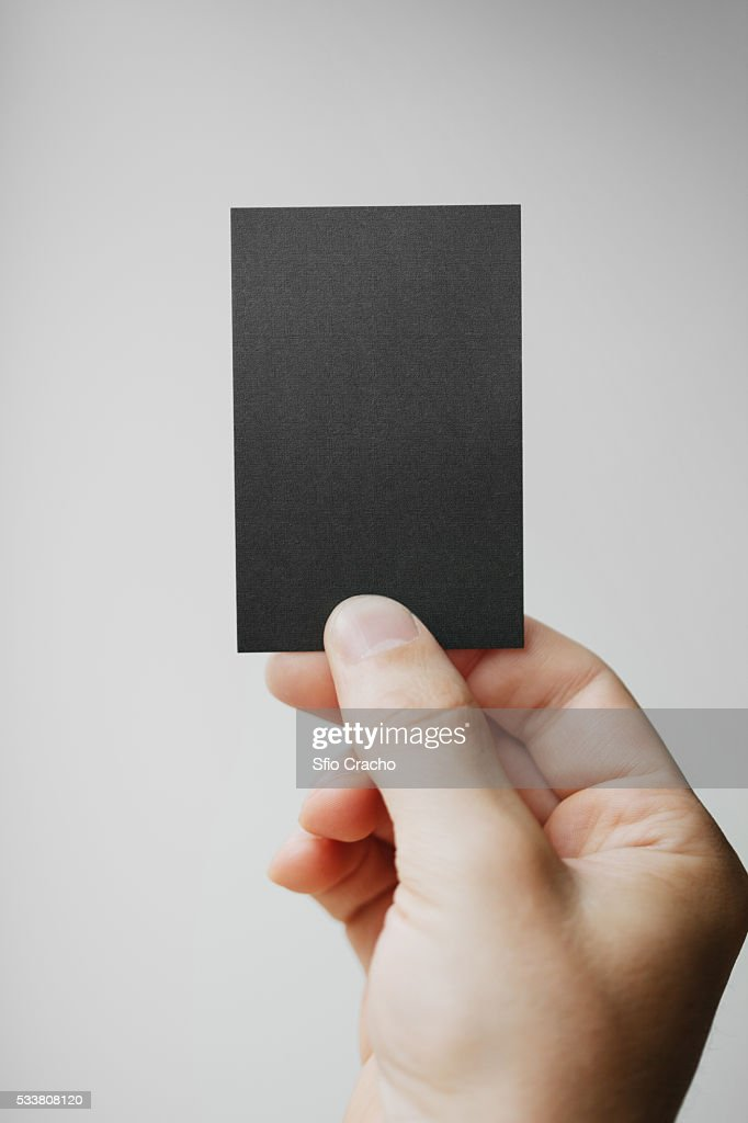 Hand holding business card : Foto stock