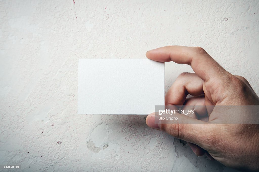 Hand holding business card : Stock-Foto
