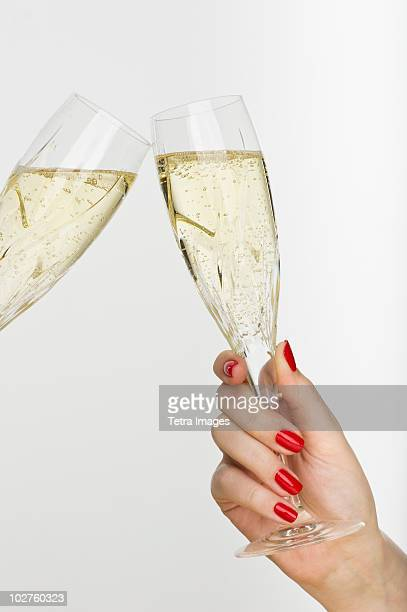hand holding champagne glass - champagne flute stock pictures, royalty-free photos & images