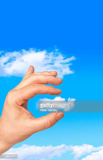 Hand holding cloud with copy space
