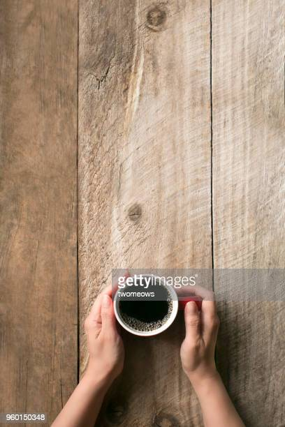 hand holding coffee cup. - black coffee stock pictures, royalty-free photos & images