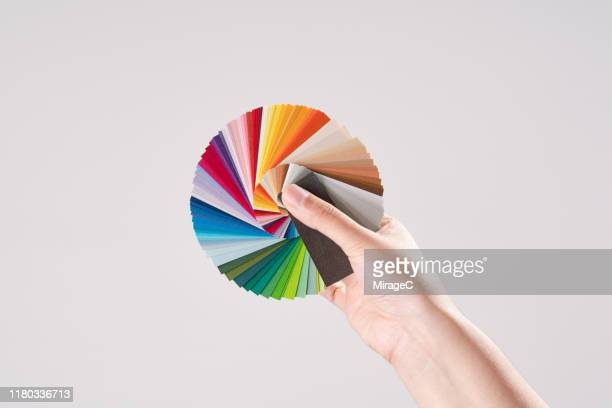 hand holding color swatches - picking stock pictures, royalty-free photos & images