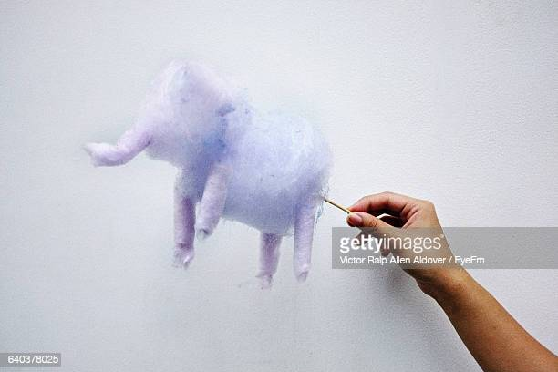 hand holding cotton candy elephant - cotton candy stock pictures, royalty-free photos & images