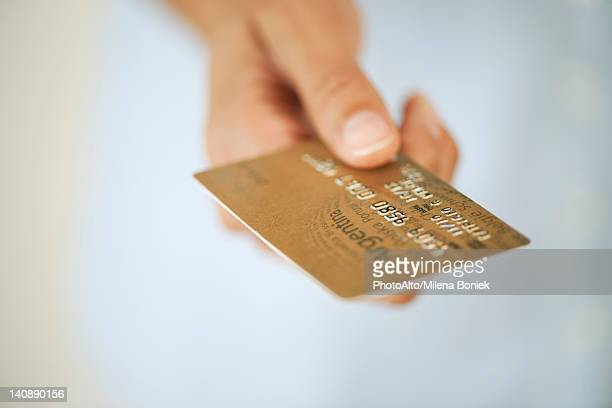Hand holding credit card, cropped