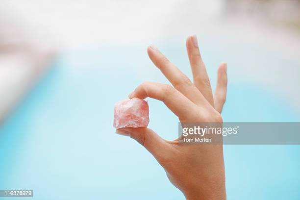 hand holding crystal at poolside - crystal stock pictures, royalty-free photos & images