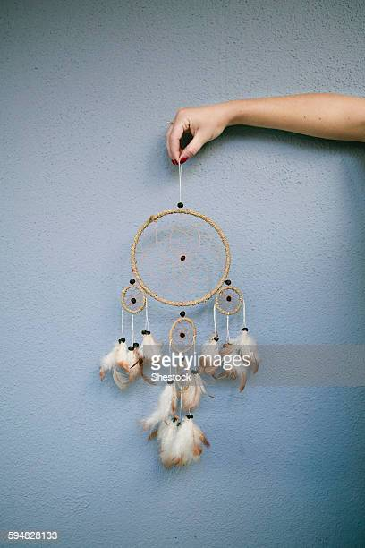 Hand holding dream catcher