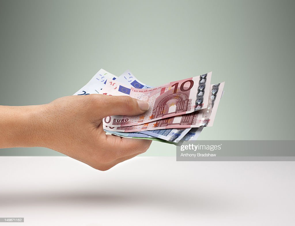Hand holding Euro currency : Stock Photo