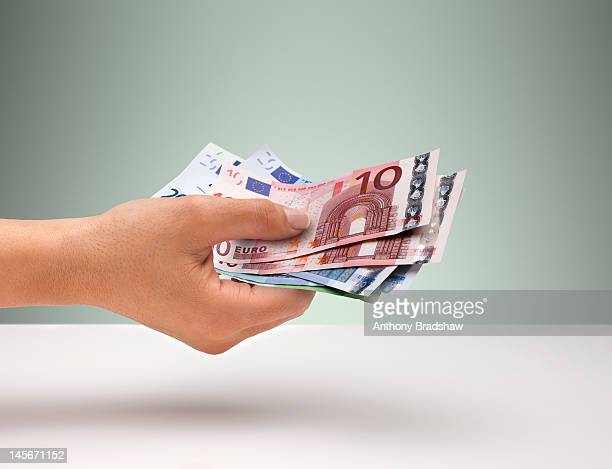 Hand holding Euro currency