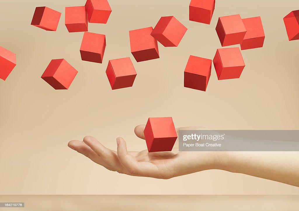 hand holding floating paper boxes in the studio : Stock Photo