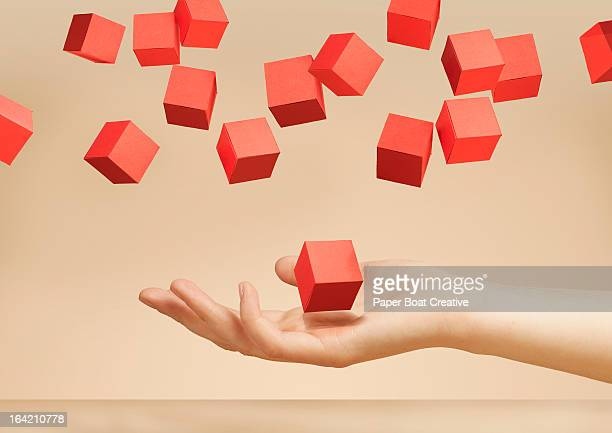 hand holding floating paper boxes in the studio - choice stock pictures, royalty-free photos & images
