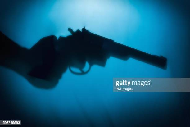 hand holding handgun - weapon stock pictures, royalty-free photos & images