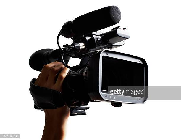 hand holding hd broadcast camcorder. - cinematographer stock pictures, royalty-free photos & images
