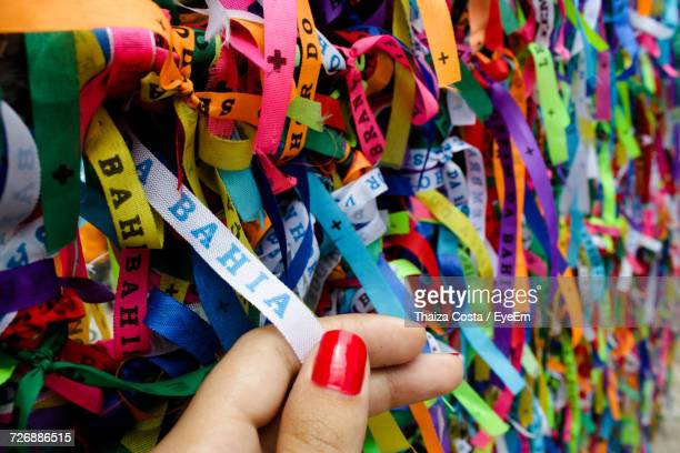 Hand Holding Holding Multi Colored Ribbons