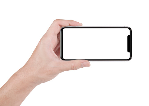 hand holding horizontal the black smartphone with white screen. 964205016