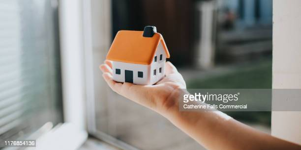 hand holding house - house icon stock pictures, royalty-free photos & images