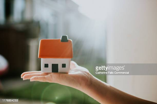 hand holding house - house stock pictures, royalty-free photos & images