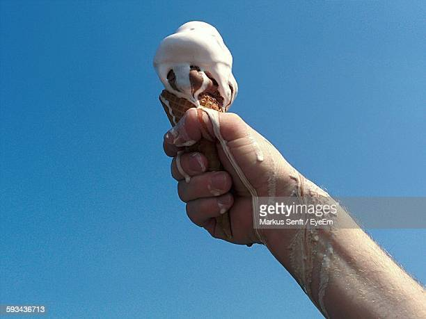 Hand Holding Ice Cream Cone