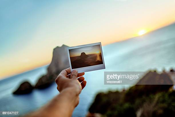 hand holding image of es vedra island, ibiza , spain - balearic islands stock pictures, royalty-free photos & images