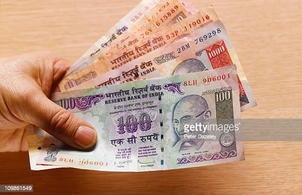 Hand holding indian bank notes