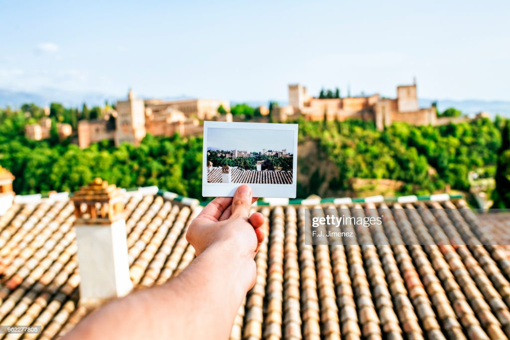 Hand holding instant photo of the Alhambra, Granada : Stock Photo