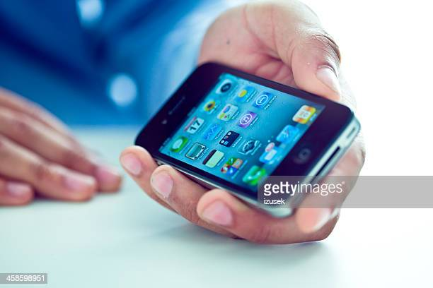 hand holding iphone 4 - izusek stock pictures, royalty-free photos & images