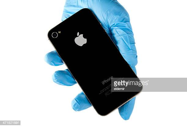 Hand holding Iphone 4