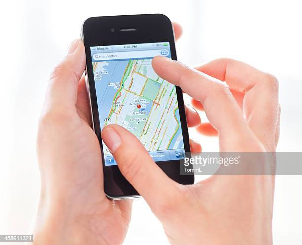 hand holding iphone 4 with google maps - google stock photos and pictures