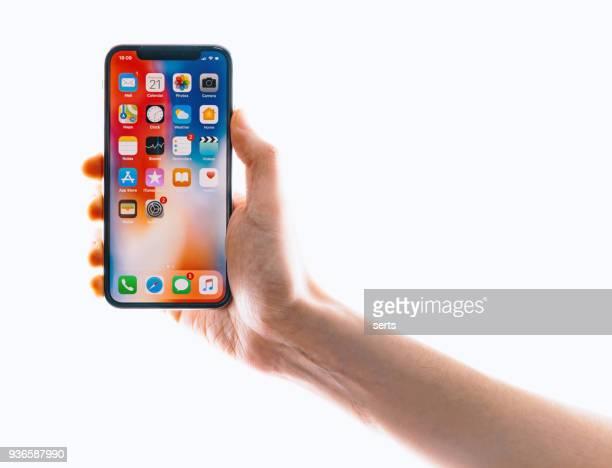 Hand halten iPhone X Silber
