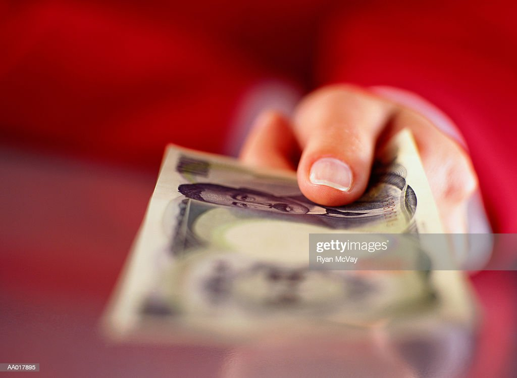 Hand Holding Japanese Yen : Stock Photo