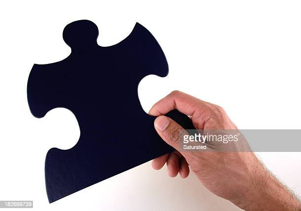 Hand Holding Large Puzzle Piece