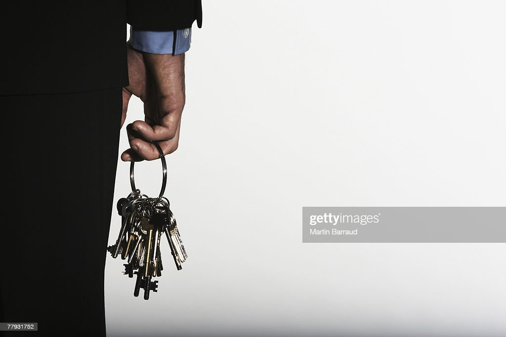 Hand holding large ring of keys : Stock Photo